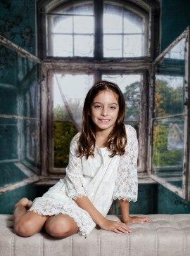 Sophia on bench with window back drop (1 of 1)