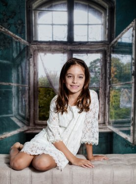 Sophia on bench with window back drop (1 of 1)